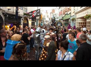 Pram Race entrants, passing through crowds in George Street, Hastings.